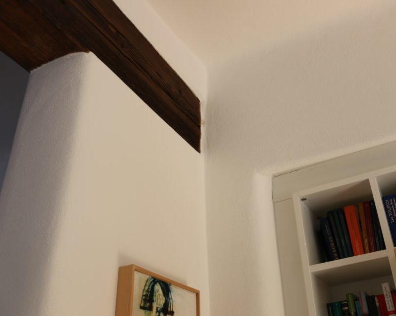 Bild einer Wand mit Putz